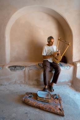 Man playing music in Santorini streets
